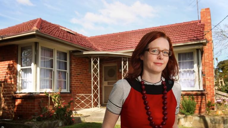 Ex blogger Amy Lewis outside her Clinker Brick home.