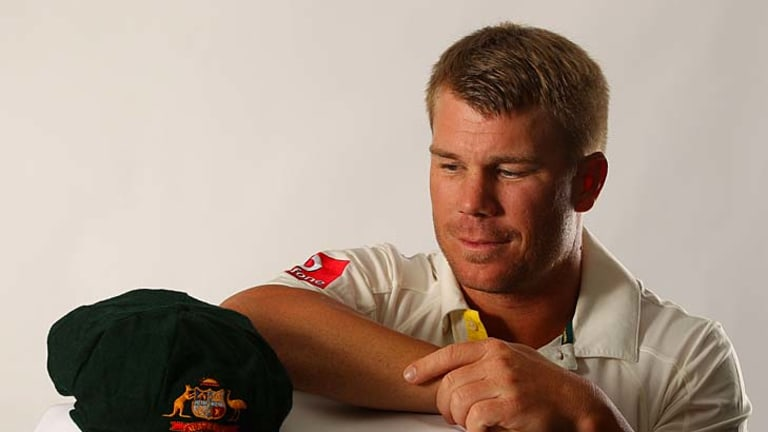 David Warner poses with a baggy green at a portrait session last month.