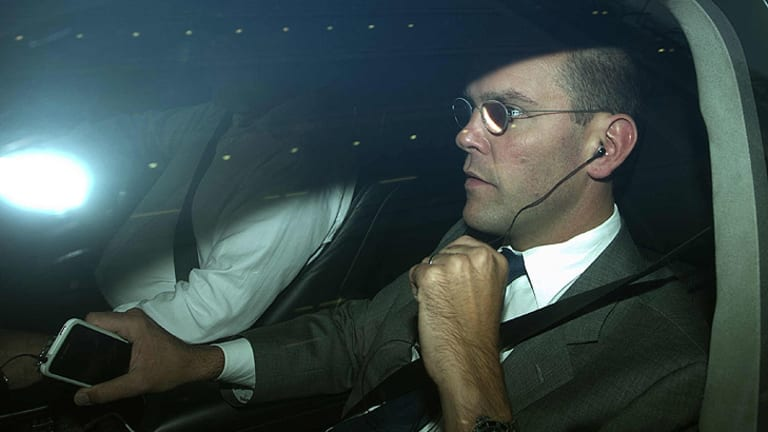 Standing down... James Murdoch is driven away from the offices of News International in London.