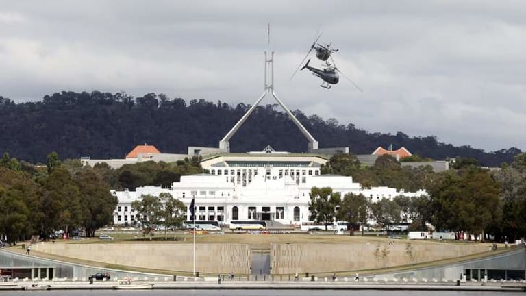 The Royal Australian Navy 723 Squadron helicopter display team rehearses for Skyfire 25 over Lake Burley Griffin.
