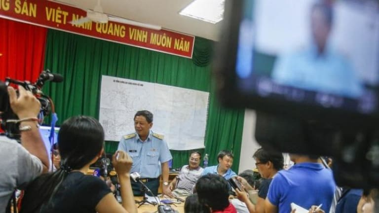 Deputy commander of Vietnam Air Force Do Minh Tuan (third from left) speaks during a news conference after a mission to find missing Malaysia Airlines flight.