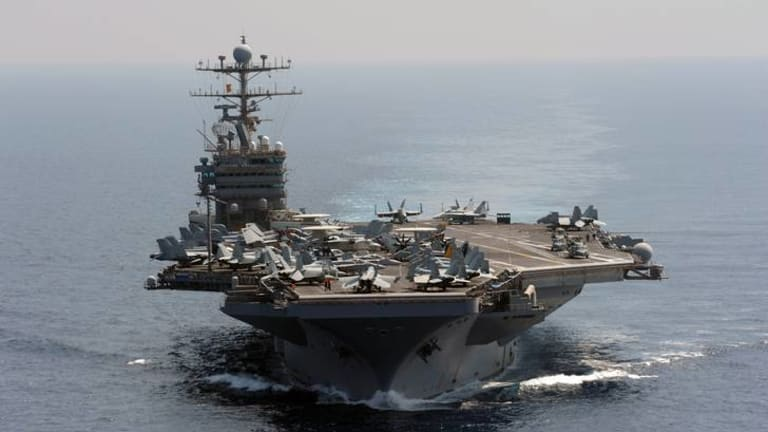 The Nimitz-class aircraft carrier USS Abraham Lincoln transits the Indian Ocean.