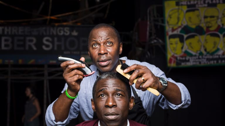 Actors Cyril Nri and Abdul Salis star in <I>Barber Shop Chronicles</I>.