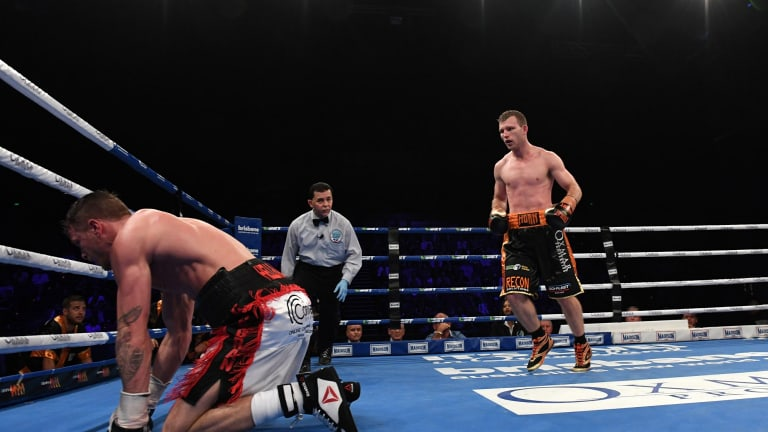 On the canvas: Gary Corcoran takes a fall during his fight against Jeff Horn.