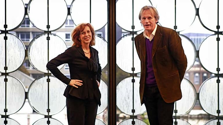 RMIT vice-chancellor Margaret Gardner and architect Sean Godsell in front of the sandblasted glass discs that pivot according to weather conditions.
