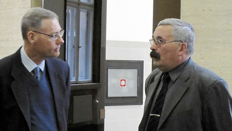 In defence … Palfreeman's father, Simon (at left) with lawyer Dinko Kanchev.