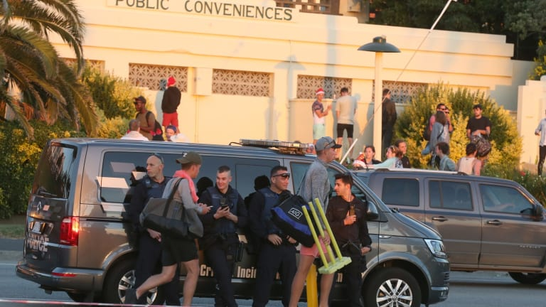 St Kilda Beach Christmas day thousands turn up drinking heavily on the beach police were on hand too keep the peace.