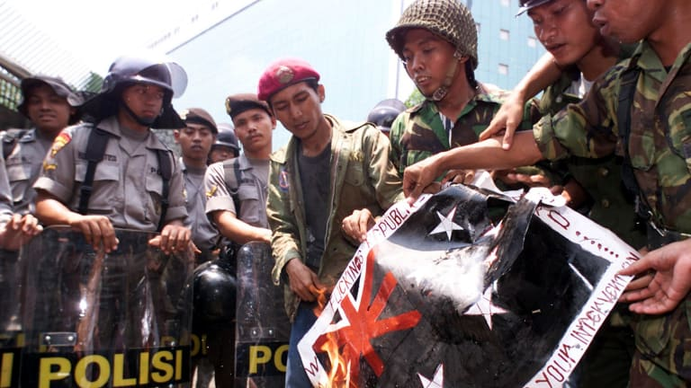 Indonesian children burn a mock Australian flag in 1999 in protest against Australia's intervention in East Timor.