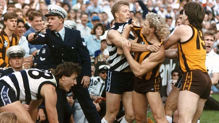 Geelong's Steve Hocking and Hawthorn's Dermott Brereton come to grips in one of several angry exchanges during the '89 grand final.