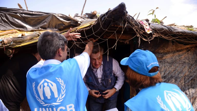 UN High Commissioner for Refugees Filippo Grandi walks out of a tent housing newly arrived Rohingya Muslims at Kutupalong refugee camp, in Bangladesh.