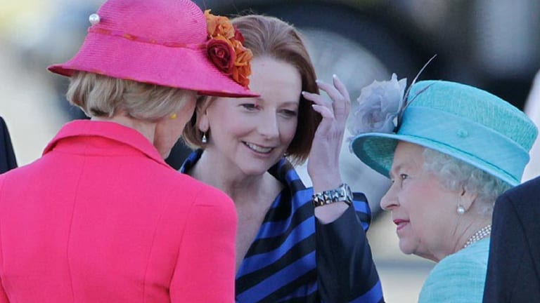 Governor-General Quentin Bryce and Prime Minister Julia Gillard chat with Her Majesty after touching down in Canberra.