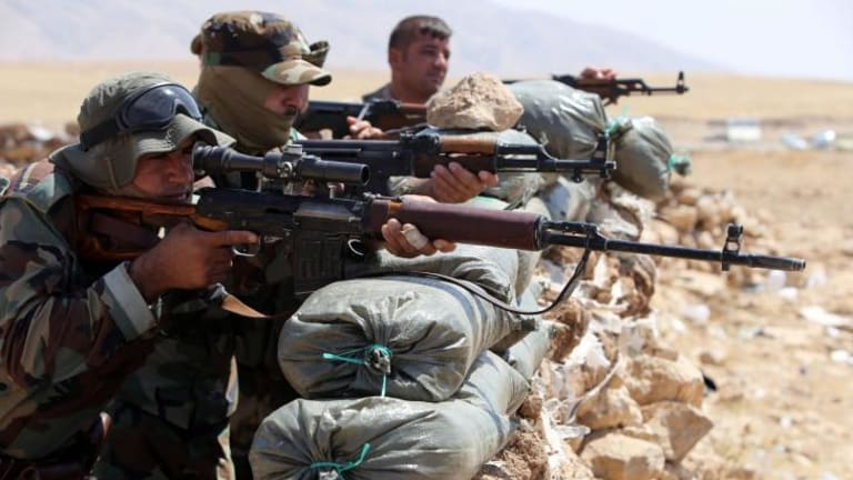 Peshmerga fighters on the front lines in Bashiqa.