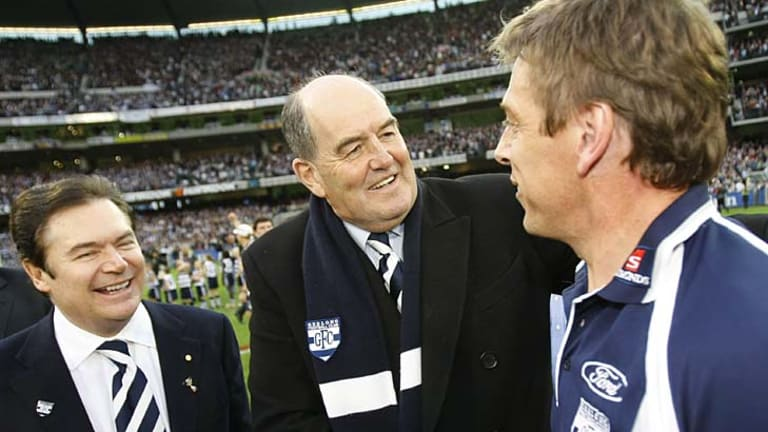 Doug Wade, centre, with Mark Thompson and Daryl Somers after the 2007 premiership win.
