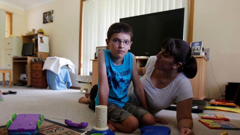 Lifelong suffering ... Debbie Waller says her disabled son, Keeden, 11, would not have been born if she had been warned about the chance of his hereditary condition.