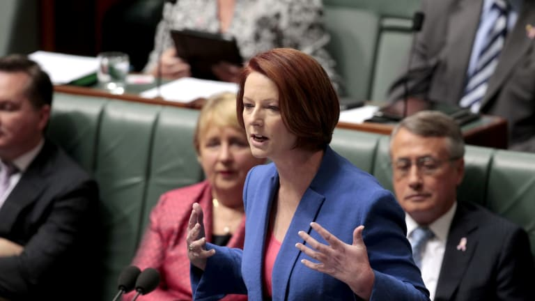 """Then prime minister Julia Gillard delivers the """"misogyny speech"""" in October 2012, a moment that gave her global attention."""