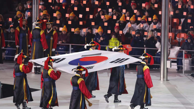Putting on a show: The South Korea flag is carried into the arena during the opening ceremony of the 2018 Winter Olympics in PyeongChang.