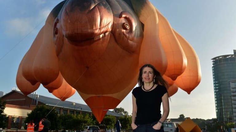 Artist Patricia Pinccinini with her Skywhale hovering above the ACCA forecourt, marking one of the art-beast's rare public appearances.
