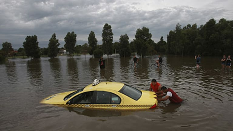 A taxi is submerged on Cranbourne Road at Narre Warren South where heavy rain caused flooding earlier this month.