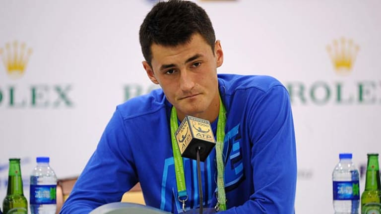 Bernard Tomic speaks to the media after his defeat.