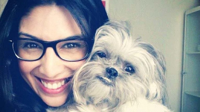 Fashion blogger and Pinterest enthusiast Christine Martinez with her dog Miles.