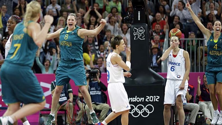Australia's Suzy Batkovic (8) and Jenna O'Hea (4) celebrate after Belinda Snell's shot.