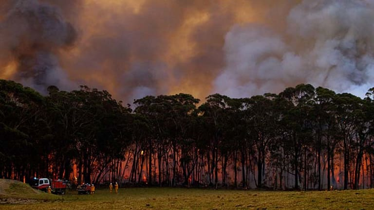 Counter-tactics: RFS Crews in Bilpin begin a backburning operation as they fight the Lithgow State Mine fire.
