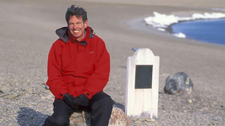 Author John Geiger, at the grave of polar explorer John Torrington, on Beechey Island, North-west Territories, in Canada.