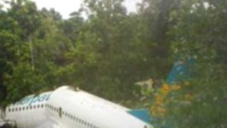 """The broken Boeing, pictured on <a href=""""http://www.papuabaratnews.com/"""">papuabaratnews.com</a>, after it came to rest."""