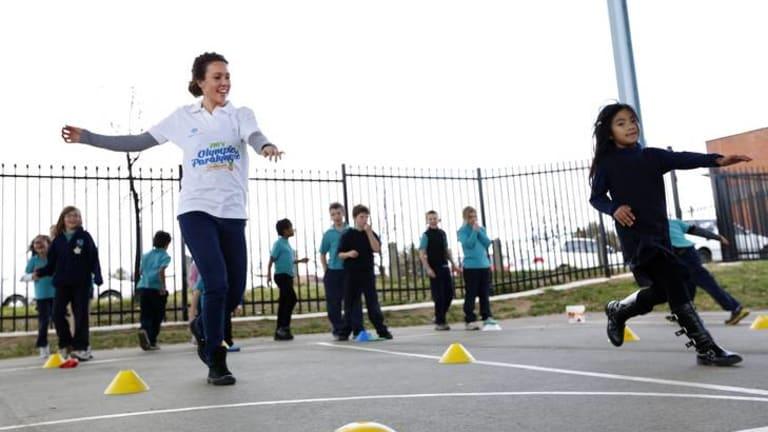 Australian Olympic Modern Pentathlete Chloe Esposito pretends to swim during games at Palmerston District Primary School.