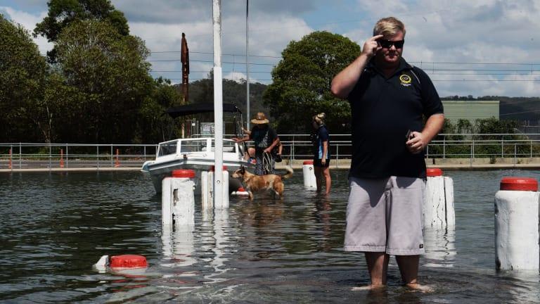 Walking on water in Woy Woy: king tide inundates a low-lying pier on Tuesday.