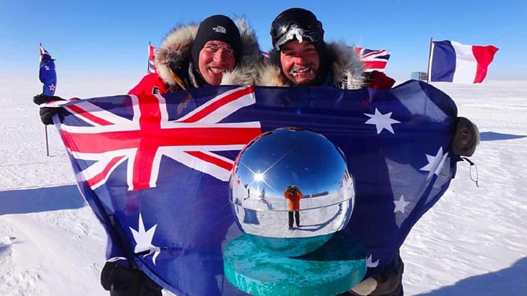 Cas (James Castrission, 29) and Jonesy (Justin Jones, 28) reach the South Pole as part of their world record attempt.