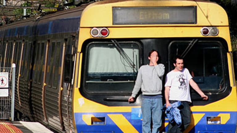 Two men hitch a ride on the express to Clifton Hill.