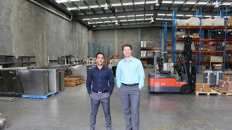 Robert Dalessandro and Adam Laurie in the Cleanawater factory.