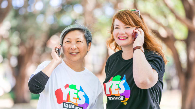 """Volunteers Anita Tang and Rebecca Wilson hosted one of hundreds of """"yes"""" campaign calling parties around the nation on Sunday at Prince Alfred Park in Sydney."""