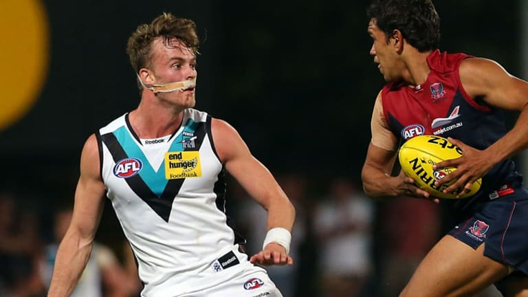 John McCarthy, left, on the field for Port Adelaide.