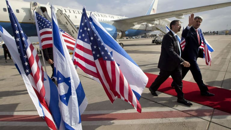 """No illusions"": US Secretary of State John Kerry walks alongside US ambassador to Israel Dan Shapiro as he arrives in Israel for a private meeting with Prime Minister Benjamin Netanyahu on Friday."