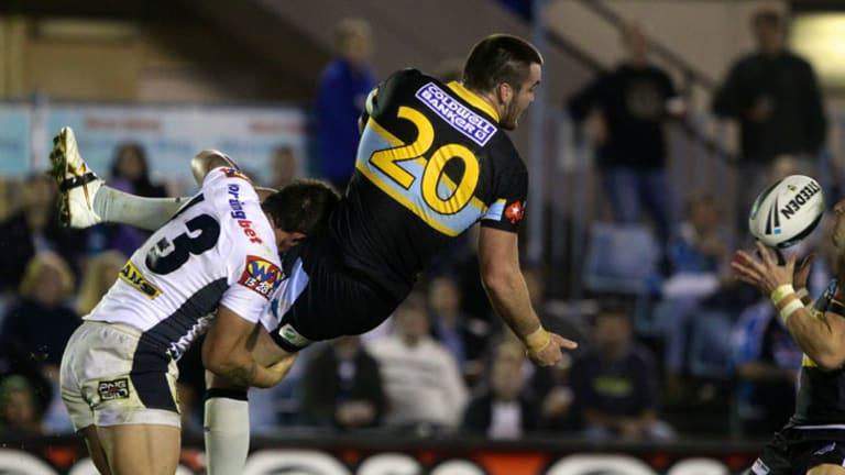 Luke Douglas of the Sharks offloads the ball.