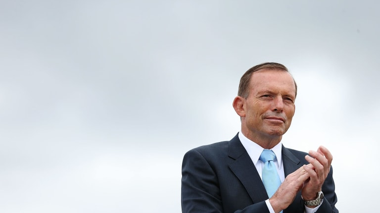 Prime Minister Tony Abbott at the flag raising and citizenship ceremony on Australia Day this year.