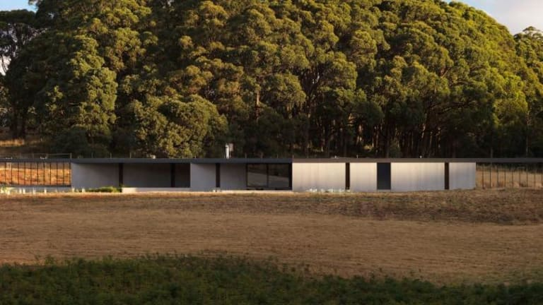 The statement house blends into its environs.