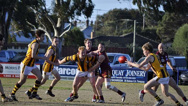 Renewed pride: Inverleigh players on the run against East Geelong. The Hawks' senior football team will today play its first finals match since the club was reborn.