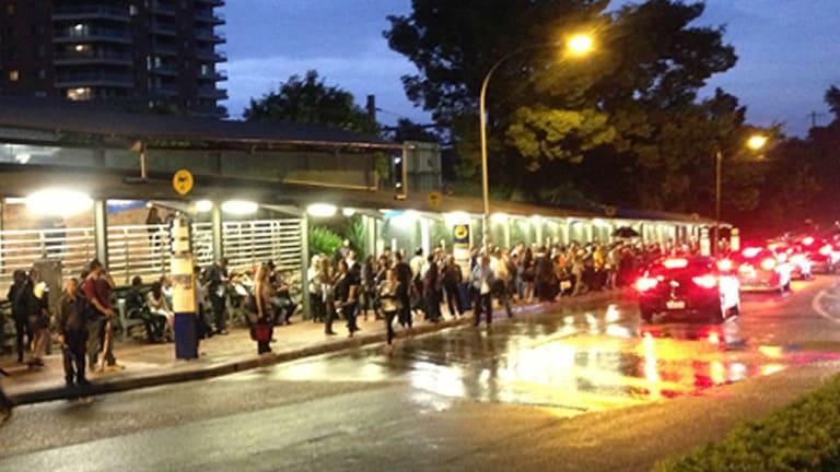 Commuters wait outside Strathfield station on Friday night.