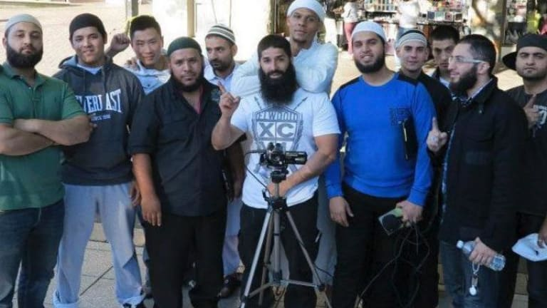 Kings Cross bouncer turned Islamic State recruiter Mohammad Ali Baryalei working for  the Street Dawah movement in Sydney. Some of the men in the photo have travelled to the Middle East.