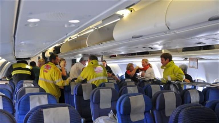 Rescue and medical workers from the Western Australian town of Exmouth met the flight after the emergency landing, 50 minutes after the first nosedive.