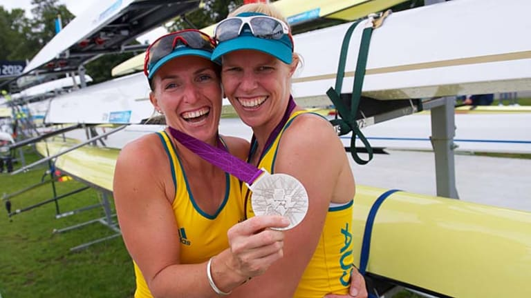 Overjoyed ... Kate Hornsey and Sarah Tait celebrate their silver medal in the women's pair at  Eton Dorney. They finished behind Great Britain.