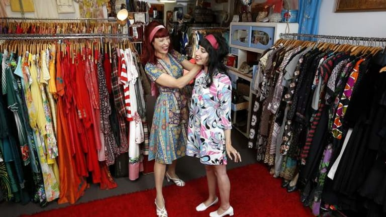 Netti from April's Caravan helps Gina Poulakis get all frocked up.