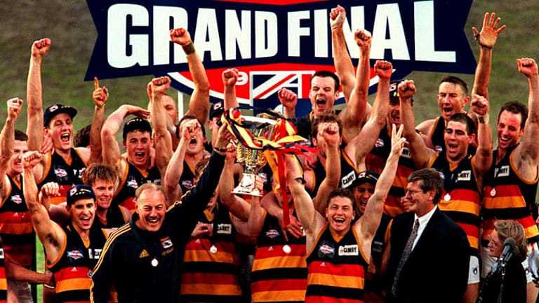 Flashback to 1998: The Crows celebrate along with coach Malcolm Blight after winning the flag.