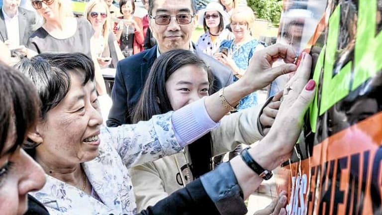 Jian Wang with daughter Charlotte and husband Zheung after buying Julia Gillard's house in Altona.