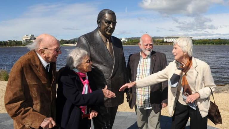 Sir Robert Menzies' daughter Heather Henderson and artist Peter Corlett with  Sir Richard and Lady Kingsland , at left, at the Sir Robert Menzies sculpture unveiling in Commonwealth Park. Sir Richard was a department head during the Menzies Government.