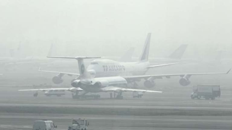 Planes are blanketed by smog at Domodedovo Airport in Moscow
