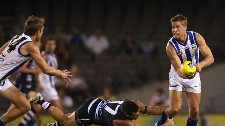 Andrew Swallow evades Shannon Byrnes in North's victory over the Cats on Sunday.